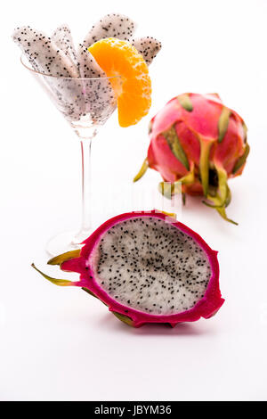 A longitudinal section of a pitaya. Its white pulp is covered with a vibrant violet skin. Its flavor is in harmony - Stock Photo