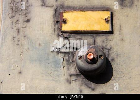 Old vintage door bell button on grunge wall Antique door bell - Stock Photo