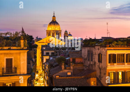 Night view of San Carlo al Corso, Chiesa di San Rocco all'Augusteo and St. Peter's cathedral in Vatican City Rome - Stock Photo