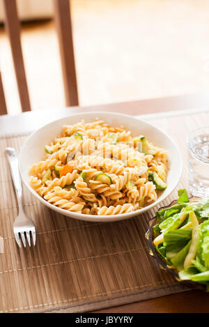plate of spiral pasta with vegetable sauce - Stock Photo
