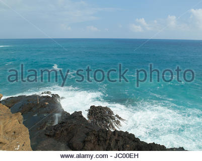 View of Halona Blow Hole from Sandy Beach, East Oahu, Hawaii, USA - Stock Photo