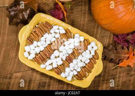 Sweet potato casserole with pecans and marshmallow topping - Stock Photo