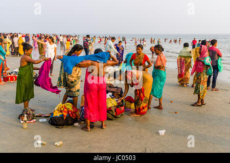 Hundreds of pilgrims are gathering on the beach of Ganga Sagar, celebrating Maghi Purnima festival - Stock Photo