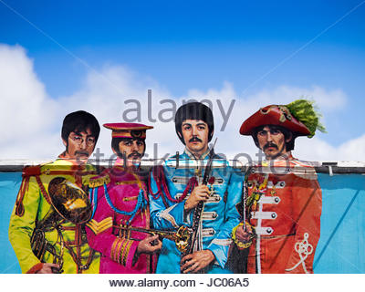 The Beatles on an unusual billboard in central London for the 50th anniversary relaunch of the Sgt Peppers album - Stock Photo