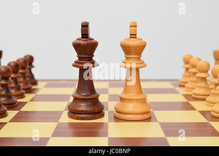 King at the center of the chessboard in a challenging attitude - Stock Photo