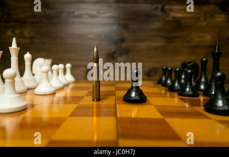 Conceptual photo of using bullet instead of chess piece. Concept of military power - Stock Photo