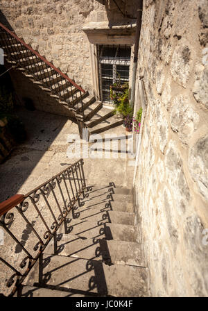 Old stone double staircase at backyard of ancient house - Stock Photo