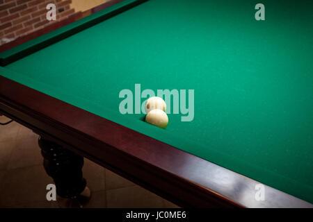 Closeup photo of two white billiard balls on table - Stock Photo