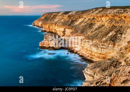 Famous Island Rock on the steep cliffs of Kalbarri National Park. - Stock Photo