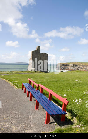 Beautiful view over the Ballybunion castle beach castle and cliffs in Ireland with wooden benches - Stock Photo