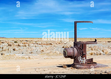 Remains of a train in the Train Cemetery in Uyuni, Bolivia - Stock Photo