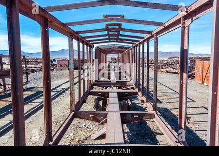 Remains of a train carriage at the Train Cemetery in Uyuni, Bolivia - Stock Photo