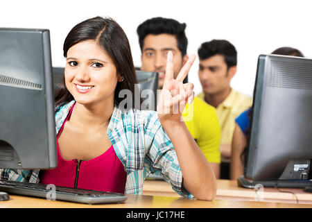 Young Woman College Student Education Victory Sign - Stock Photo