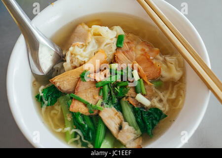 Egg noodle soup with red roast pork. - Stock Photo