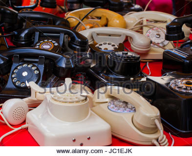 View of vintage telephones in the street market - Stock Photo