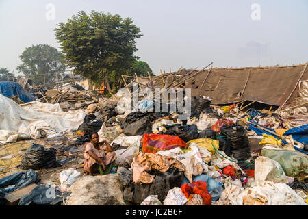 A woman is sorting out recyclable materials in Dhapa Garbage Dump - Stock Photo