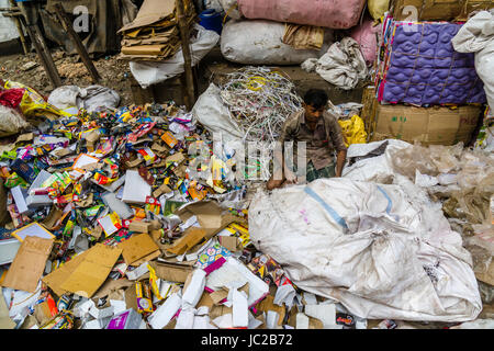 A man is sorting out recyclable materials in Dhapa Garbage Dump - Stock Photo