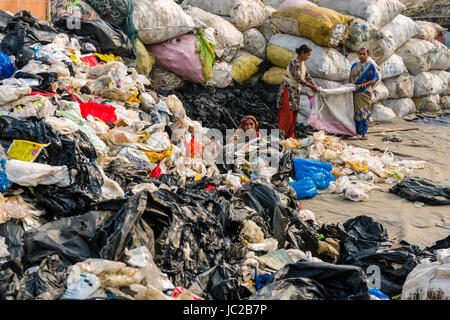 Women are sorting out recyclable materials in Dhapa Garbage Dump - Stock Photo