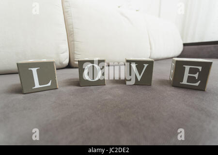 Macro photo of word Love spelled by letters on wooden bricks - Stock Photo