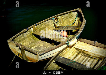 A Simple Nautical Still Life Consisting Of Two Old Boats Against A Dark Background - Stock Photo