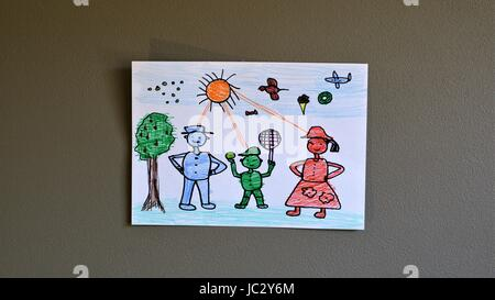 Kid's drawing and coloring on the wall - Stock Photo