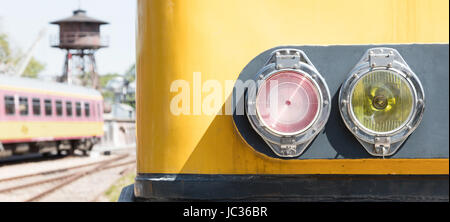 Closeup of a train headlight shining, vintage train - Stock Photo