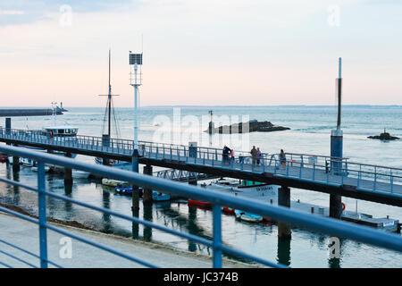 LE CROISIC, FRANCE - JULY 26, 2014: pier in Le Croisic town, France at sunset. Le Croisic is town in Loire-Atlantique - Stock Photo