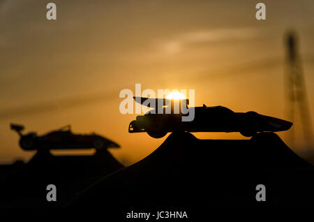 View of two historic cars with sunset in background - Stock Photo