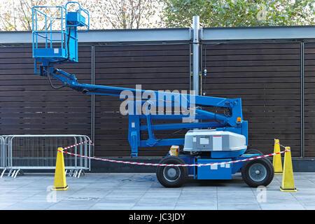 Self propeled blue telescopic boom lift platform - Stock Photo