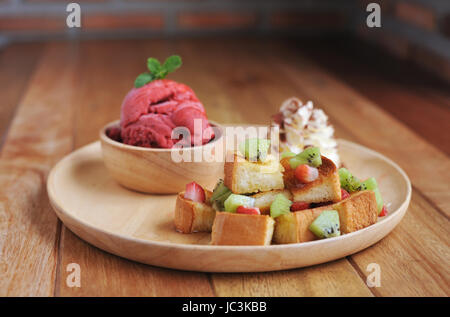 Homemade Organic Strawberry fruit ice cream in bowl - Stock Photo