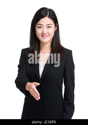 Business woman give handshake - Stock Photo