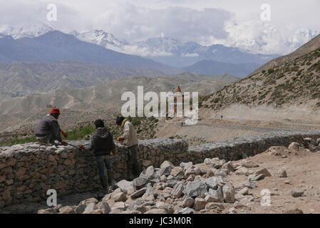 The chinese are building a road through Mustang to link up through India, it will disrupt trekking!! - Stock Photo