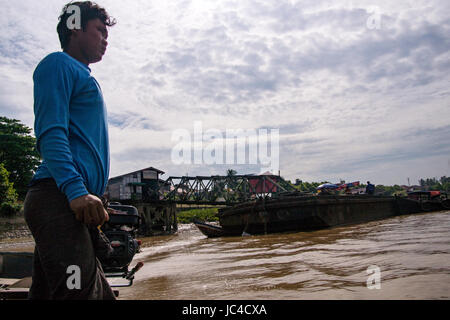 Ferry man and boat crossing Selween to Bilu Island, Myanmar. - Stock Photo