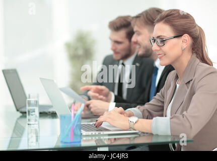 Image of business partners discussing documents and ideas at mee - Stock Photo
