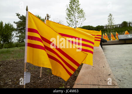 south vietnamese flags at the Philadelphia republic of south vietnam freedom and heritage flag monument memorial - Stock Photo
