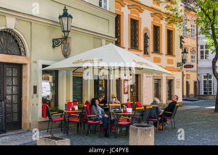 Outdoor cafe in the old town, Prague, Bohemia, Czech Republic - Stock Photo