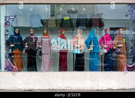 KOTA KINABALU, MALAYSIA - JUNE 10, 2017: Clothing store displaying mannequins in beautiful dresses, hijab and accessories - Stock Photo