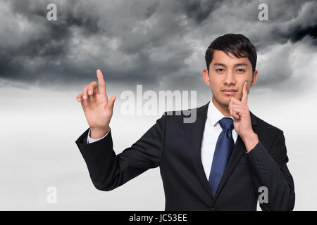 Composite image of thoughtful businessman touching - Stock Photo