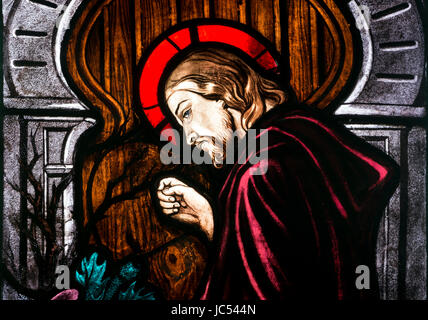 Christ knocking on the door stained glass, St. Peter and St. Paul`s Church, King`s Sutton, Northamptonshire, UK - Stock Photo