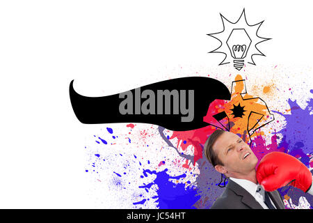 Composite image of businesswoman hitting colleague with her boxing gloves - Stock Photo