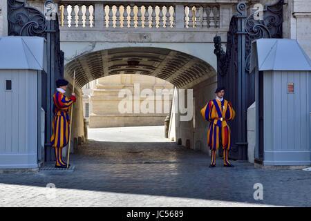 Vatican Swiss Guards standing sentry by St. Peter's Basilica (Basilica di San Pietro) Vatican City, Rome - Stock Photo
