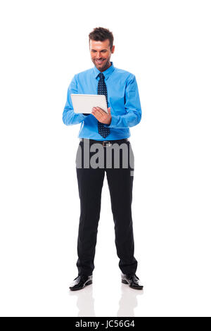 Man checking something on his tablet - Stock Photo