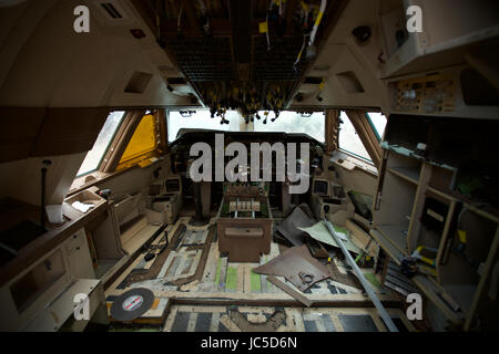 Where passenger aircraft go to die. Inside the flight deck of a retired aircraft after it has been stripped by Air - Stock Photo