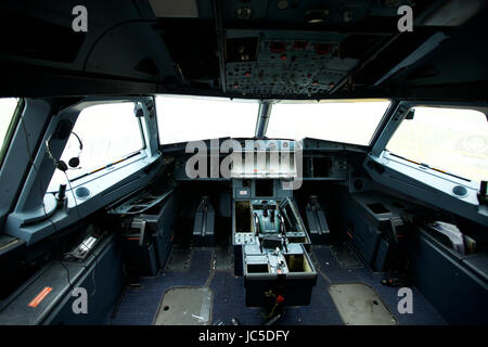 Where passenger aircraft go to die. Inside the stripped cockpit of an old passenger jet at Air Salvage International, - Stock Photo