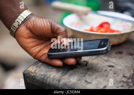 A woman using her mobile phone, Nigeria, Africa - Stock Photo