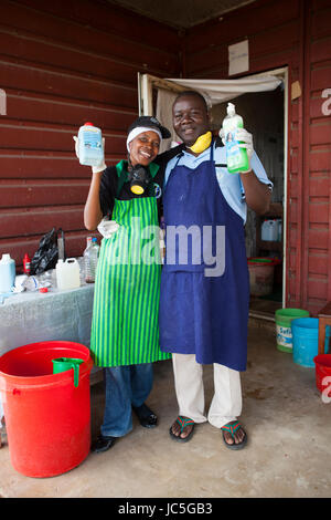 Small business owners who produce cleaning products. Tanzania, Africa - Stock Photo