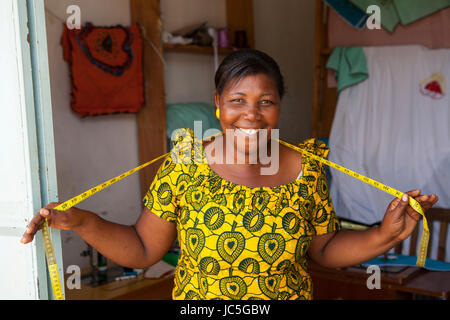 Female tailor in her shop, Tanzania, Africa. - Stock Photo