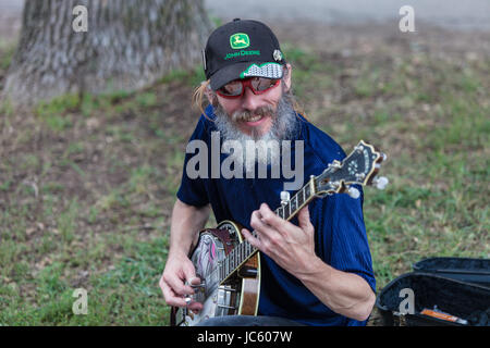 DES MOINES, IA /USA - AUGUST 10: Unidentified banjo player at the Iowa State Fair on August 10, 2014 in Des Moines, - Stock Photo