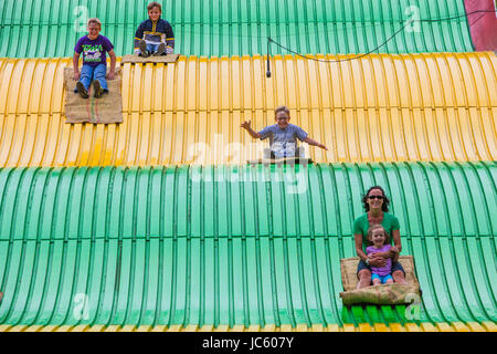 DES MOINES, IA /USA - AUGUST 10: Unidentified people on jumbo slide at the Iowa State Fair on August 10, 2014 in - Stock Photo