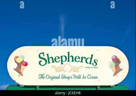 Shepherds original sheep's milk ice cream sign under blue sky at Hay Festival 2017 Hay-on-Wye Powys Wales UK - Stock Photo